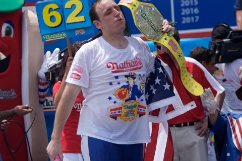 Joey Chestnut wins first place with 62 hot dogs in ten minutes in the 2011 Nathan's Famous Fourth of July International Hot Dog Eating Contest at Coney Island