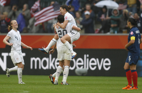 Players of the U.S. celebrate victory after the Women's World Cup semi-final soccer match against France in Monchengladbach