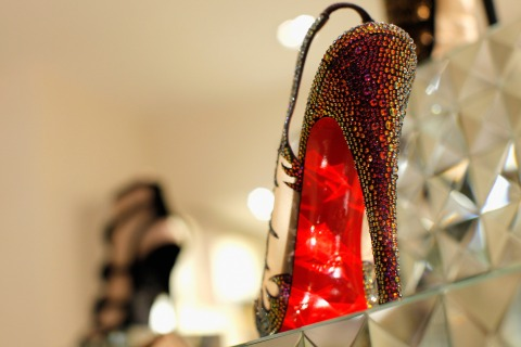 """Christian Louboutin's """"Maralena Crystal-Covered Mesh Peep-Toe Pump"""" features the brand's signature red-lacquered sole."""