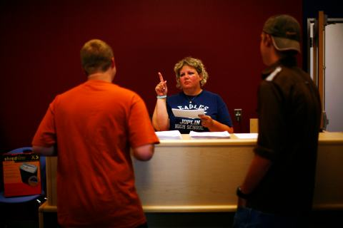 Students get their class schedules during an open house at Joplin High School in Missouri
