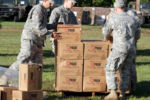 National Guard troops stack emergency provisions  on Tuesday in Colchester, Vt.