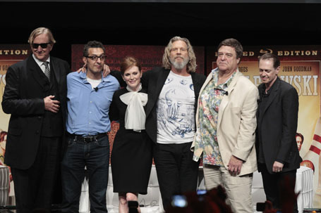 """Music producer T Bone Burnett smiles with cast members at an event celebrating the Blu-Ray dvd release of the film """"The Big Lebowski"""" in New York"""