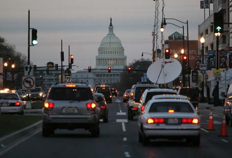 The Capitol Building is shown as traffic passes Nationals Park in Washington