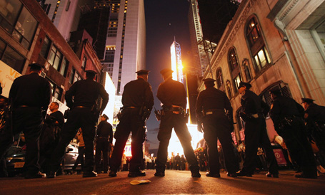 Police keep watch as demonstrators associated with the 'Occupy Wall Street' movement protest in Times Square on October 15, 2011 in New York City.