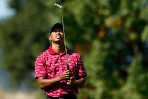 Tiger Woods looks at his putter on the third green during the final round of a PGA Tour golf tournament in San Martin