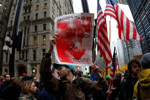"Occupy Wall street demonstrators move through the streets of lower Manhattan near the New York Stock Exchange during what organizers called a ""day of action"" in New York"