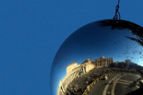St. Peter Square is reflected in a Christmas decoration hanging from a Christmas tree in the Vatican