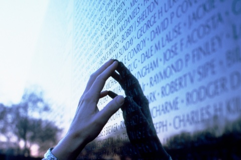 Hand on the Vietnam Veterans Memorial