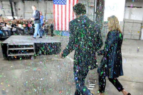 "U.S. Republican presidential candidate Romney and his wife are ""glitter bombed"" while making their way to the stage in Eagan"