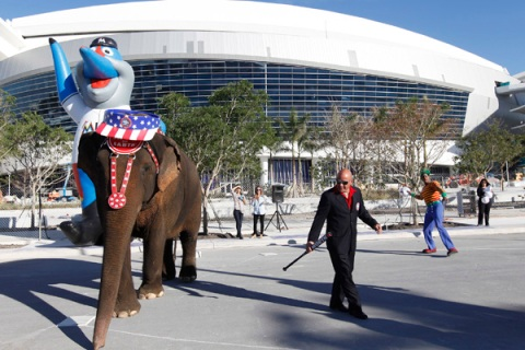 """Ringling Brothers and Barnum and Bailey Circus animal trainer Maluenda guides an Indian elephant named Asia around the """"bases"""" of a makeshift baseball field in Miami"""
