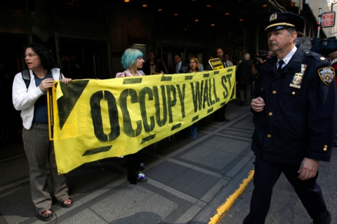 Occupy Wall Street demonstrators protest against Republican Presidential candidate  Mitt Romney outside the Waldorf Astoria Hotel in New York.