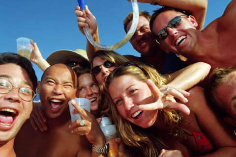 Spring Break: group of young people wearing swimsuits, drinking beer, portrait