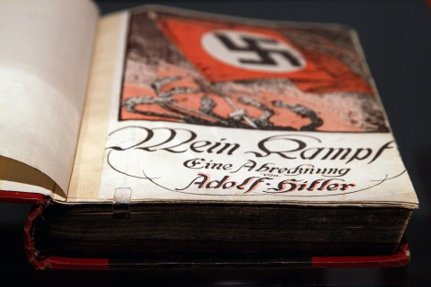 BERLIN - OCTOBER 13:  The book 'Mein Kampf' (My Struggle) is pictured during a press preview of 'Hitler and the Germans Nation and Crime' (Hitler und die Deutschen Volksgemeinschaft und Verbrechen) at Deutsches Historisches Museum (German Historical Museum) on October 13, 2010 in Berlin, Germany. The exhibition seeks to answer the question of why so many Germans chose to follow Hitler and his fascist ideology and so devotedly despite the horrors of World War II and the Holocaust. The exhibition will be open to the public from October 15 until February 6, 2011.  (Photo by Andreas Rentz/Getty Images)