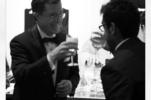 Stephen Colbert toasts with TIME staff writer Ishaan Tharoor at the TIME100 gala.