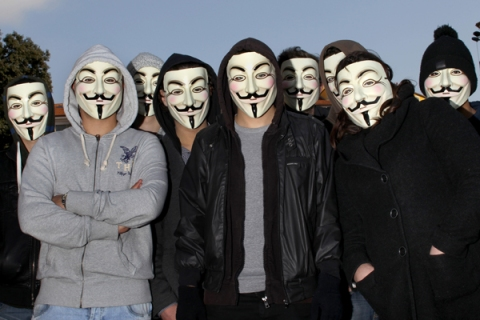 Protesters wearing Anonymous Guy Fawkes