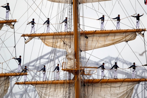 Crew members of the Guayas-Ecuadorian Tall Ship stand atop the ship mast as they make their way up the Mississippi River into the Port of New Orleans during NOLA Navy Week and Commemoration of the Bicentennial of the War of 1812 in New Orleans, Louisiana