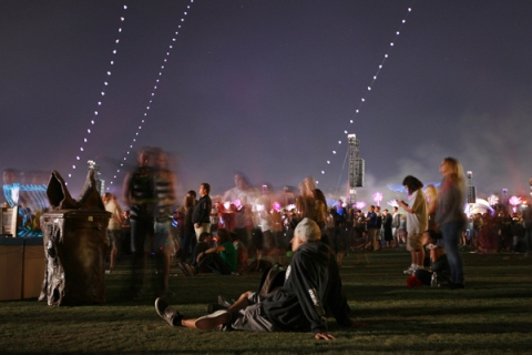 People watch a performance on the last night of the Coachella Valley Music and Arts Festival in Indio
