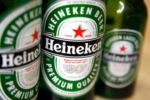 Bottles of Heineken beer sit on display in a shop in Berlin,