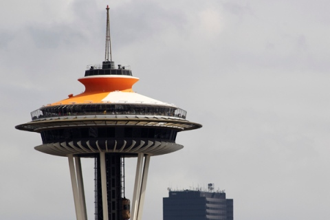 """Space Needle is pictured being painted in throwback """"Galaxy Gold"""" in Seattle"""