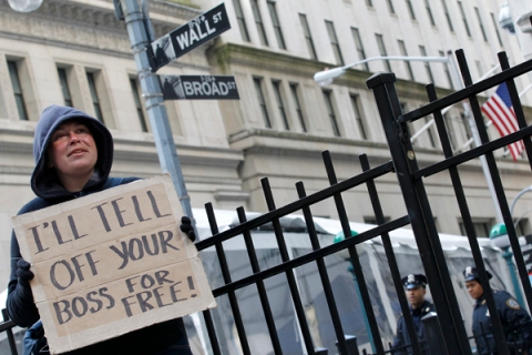 Occupy Wall Street demonstrators protest outside the New York Stock Exchange