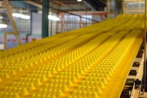 Marshmallow candy Peeps chicks move down a conveyor belt ins