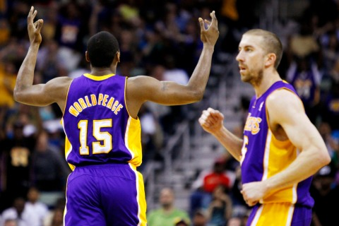 Los Angeles Laker Metta World Peace reacts after hitting a three-pointer during a Lakers game against the New Orleans Hornets  in New Orleans