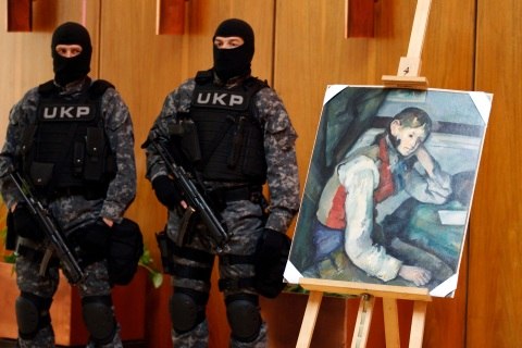 """Serbian special police guard what is believed to be an impressionist masterpiece """"Boy in a Red Waistcoat"""" by Paul Cezanne in Belgrade"""