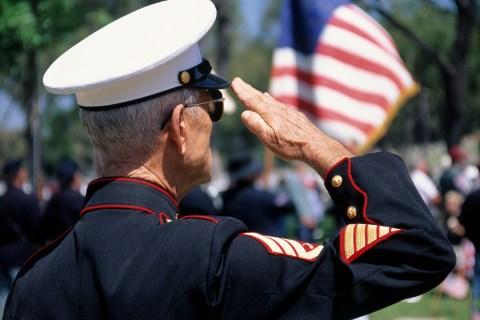 Retired Marine in dress uniform saluting