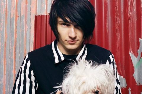 Young man with dog, emo haircut