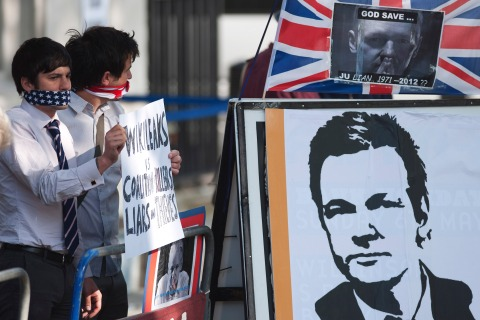 Protesters supporting Wikileaks founder Julian Assange hold placards outside the Supreme Court in London