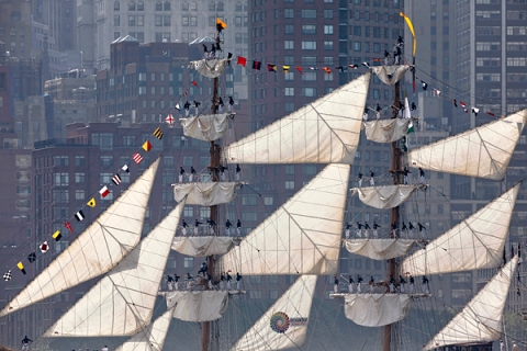 Sailors line the mast of ARC Gloria while arriving for the 25th annual Fleet Week celebration in New York