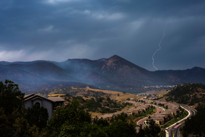 Lighting strikes as rain clouds approach the Waldo Canyon fire in Colorado Springs, Colorado