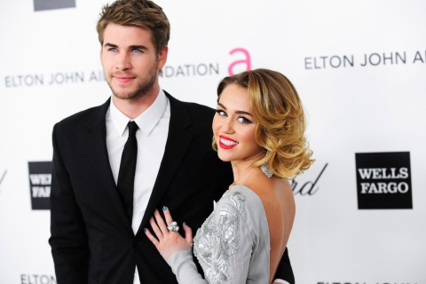 Singer Cyrus and actor Hemsworth arrive at the 20th annual Elton John AIDS Foundation Academy Awards Viewing Party in West Hollywood, California