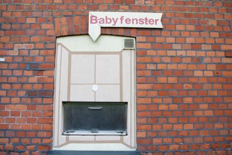 A 'Babyklappe', with a sign 'Babywindow', is pictured at a hospital in Essen