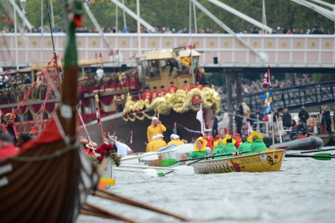 Participants row their boats during Queen Elizabeth's Thames Diamond Jubilee Pageant on the River Thames in London