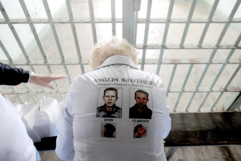 Wearing a shirt celebrating her brothers' escape from Alcatraz Island's federal prison, a sister of John and Clarence Anglin visits the former prison
