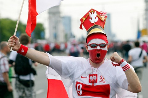 A Polish soccer fan shouts on his way to the National Stadium in Warsaw