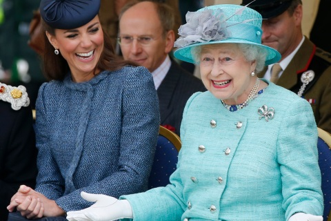 Britain's Catherine, Duchess of Cambridge laughs as Queen Elizabeth gestures while they watch part of a children's sports event during a visit to Vernon Park in Nottingham