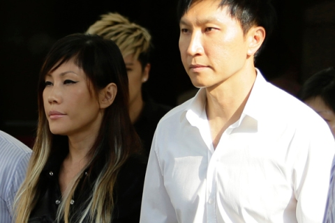 City Harvest Church founder Kong Hee holds the hand of his wife as he exits the Subordinate Courts in Singapore
