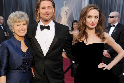 Brad Pitt arrives at the 84th Annual Academy Awards with his mother Jane and partner Angelina Jolie