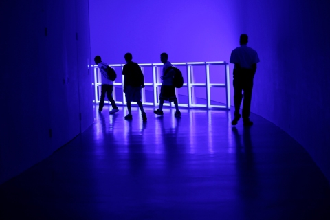 Visitors walk through an exhibit at the Smithsonian Institution's Hirshhorn Museum in Washington