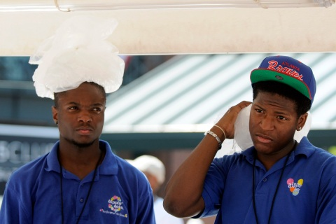 Turner Field vendors Smith and Jernigan use bags of ice to stay cool while working at baseball game between Atlanta Braves and Washington Nationals in Atlanta