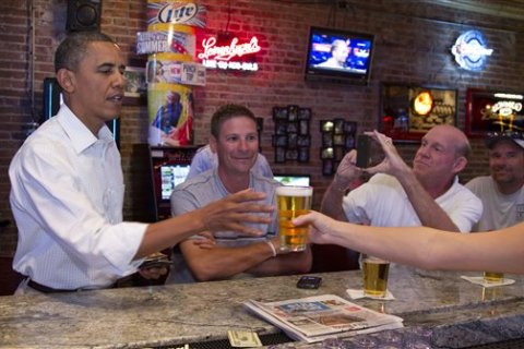 image: President Barack Obama stops for a beer at The Pump House, a pub and grill, in Cedar Falls, Iowa, Aug. 14, 2012.