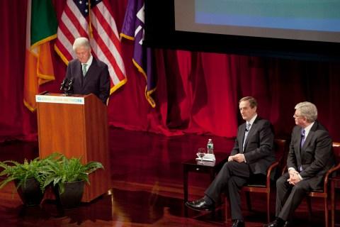 Former U.S. President Clinton speaks next to Ireland's Prime Minister Kenny