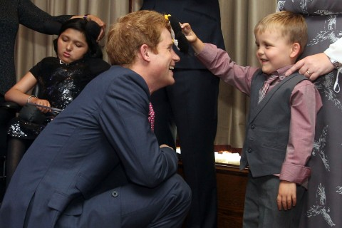 Britain's Prince Harry talks to Alex Logan, aged six, as he attends the WellChild awards ceremony at the InterContinental Hotel in London