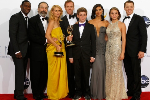 """The cast of """"Homeland"""" pose after the series won the Emmy award for outstanding drama series at the 64th Primetime Emmy Awards in Los Angeles"""