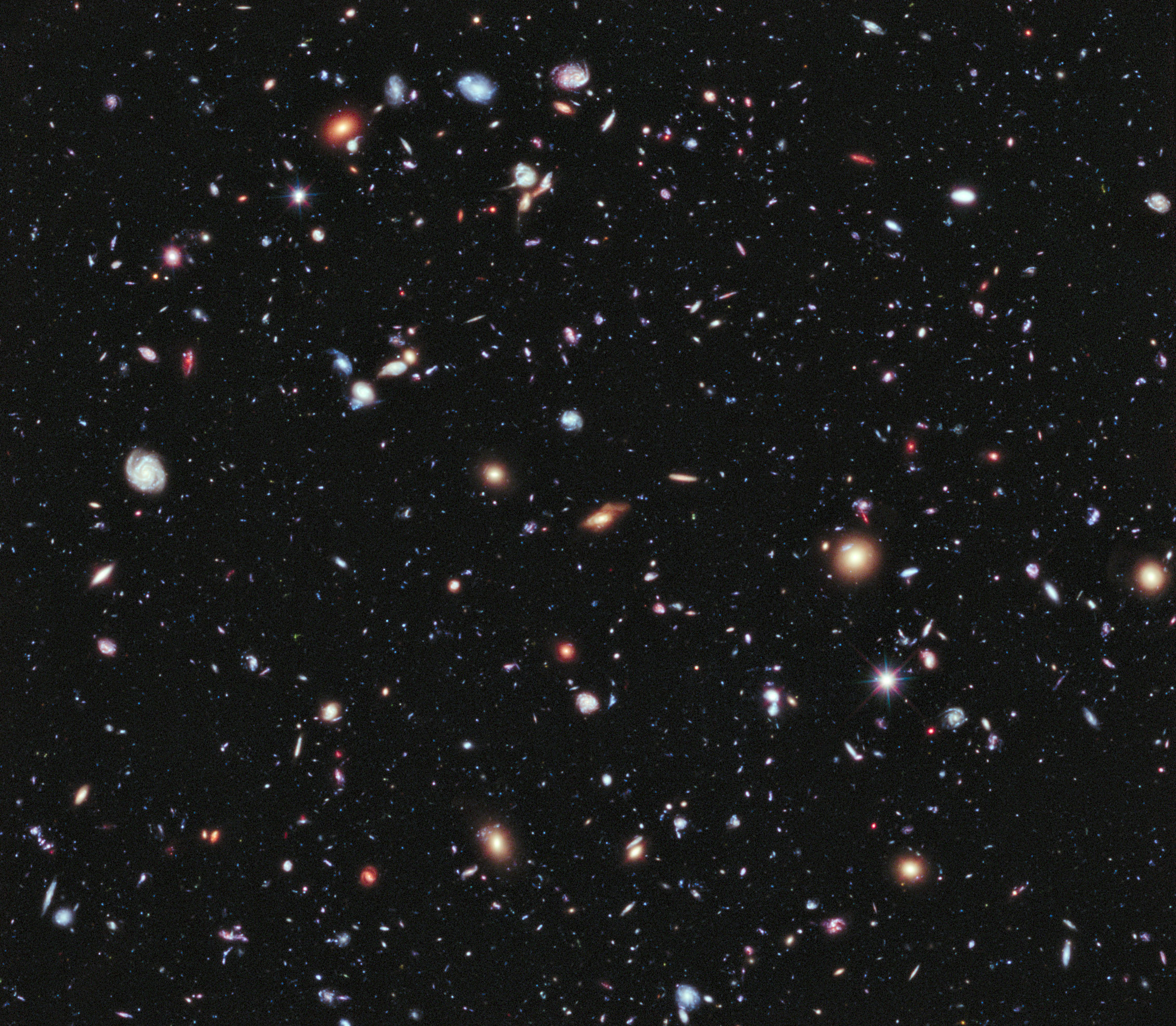 Image: A new, improved portrait of Hubble's deepest-ever view of the universe, called the eXtreme Deep Field, or XDF, in the constellation Fornax