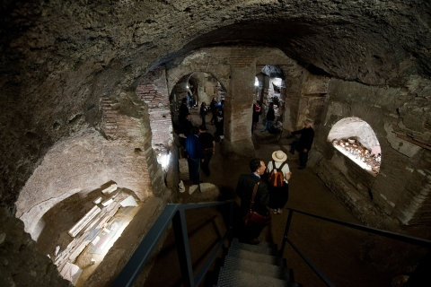 """Visitors walk around the """"Cubicle of Apostles"""" in the restored part of Roman catacombs of Santa Tecla, in Rome on June 22, 2010."""