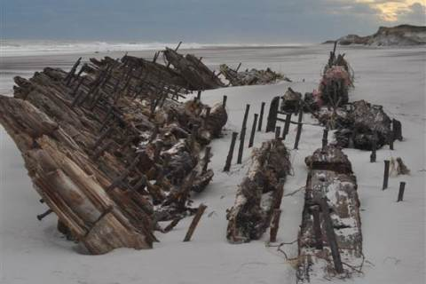 image: The presumed remains of the Bessie White, a wrecked schooner long buried under Fire Island's dunes, now rests fully exposed on the beach following Hurricane Sandy.