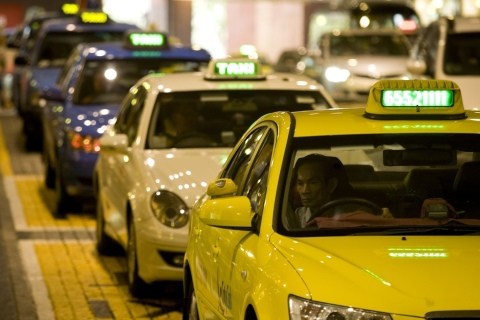 A Citycab taxi, owned by ComfortDelgro Corp., waits for a pa